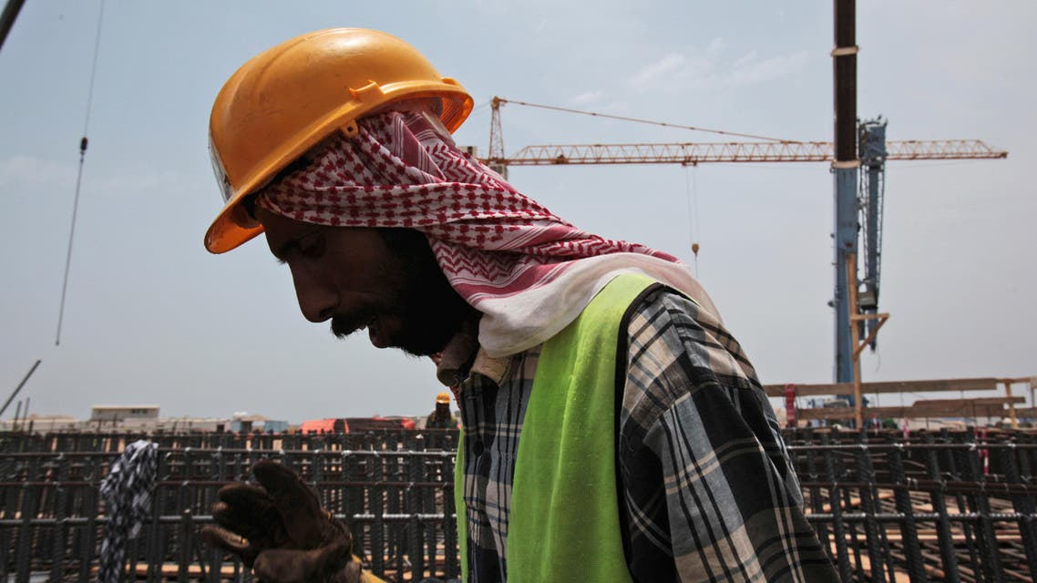 In this May 8, 2014, file photo a man works on construction of the Kingdom Tower, a planned 252-story building, which aims to become the world's tallest skyscraper when complete, in Jiddah, Saudi Arabia. ap