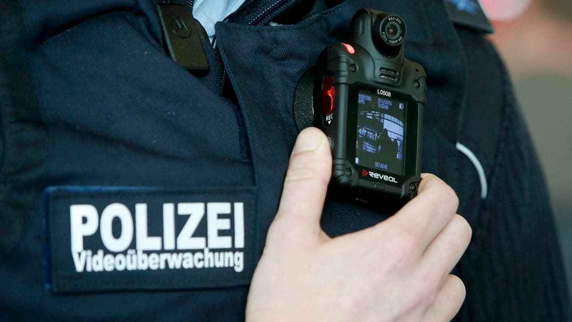 A German federal police officer poses with his video surveillance camera during a drill at Ostbahnhof train station in Berlin, Germany April 4, 2016. (Reuters)