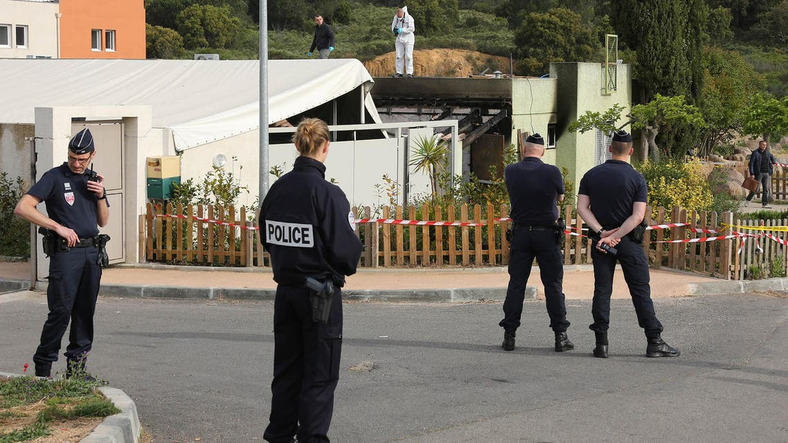 Police officers stand outside a Muslim prayer room set on fire early in the morning in Ajaccio, French Mediterranean island of Corsica, Saturday, April 30, 2016. (AP)