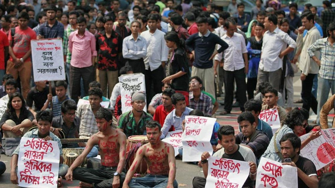 "Bangladeshi students and social activists protest against the killing of Avijit Roy, in Dhaka, on Friday. Posters read, as ""we want punishment for Avijit Roy's killers."" And ""How many dead bodies we have to see?"" (Source: AP)"