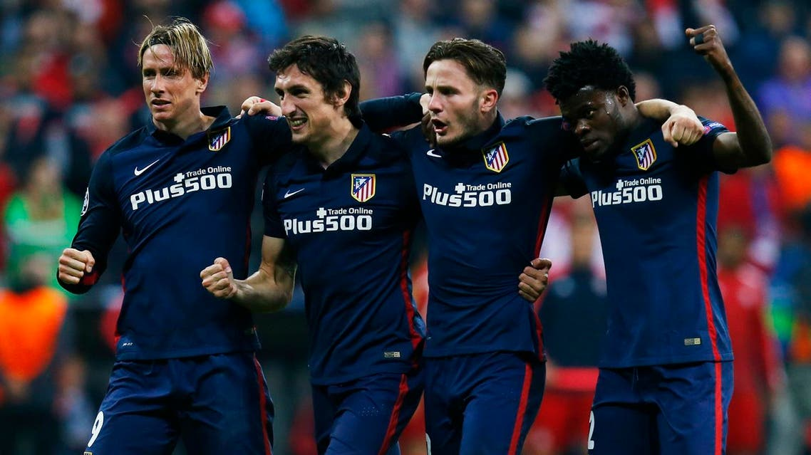 Atletico Madrid's Fernando Torres, Stefan Savic, Saul Niguez and Teye Thomas celebrate at the end of the game Reuters