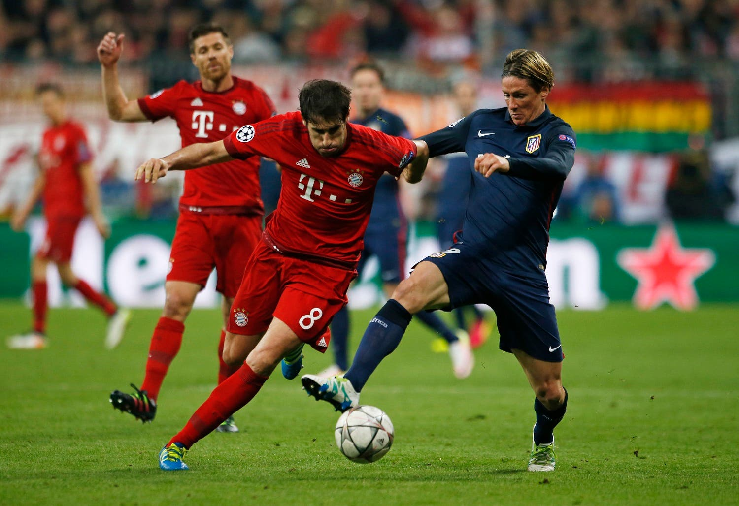 Atletico Madrid's Fernando Torres in action with Bayern Munich's Javi Martinez. (Reuters)