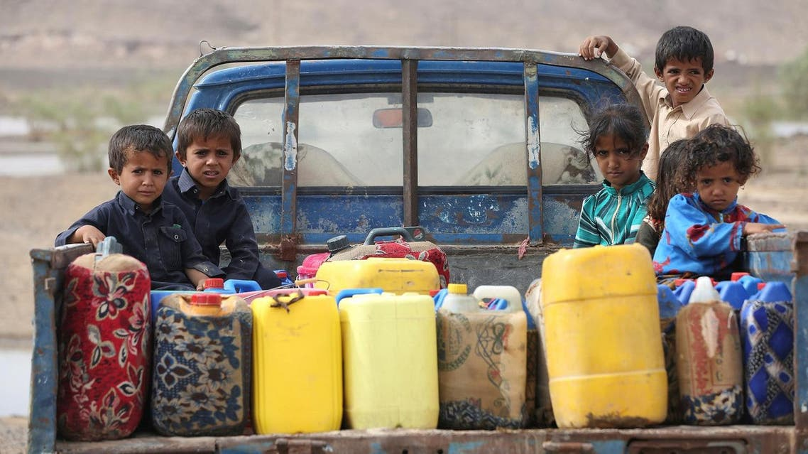 Children ride on the back of a truck loaded with water jerrycans at a camp for internally displaced people in the Dhanah area of the central province of Marib, Yemen, April 30, 2016. REUTERS