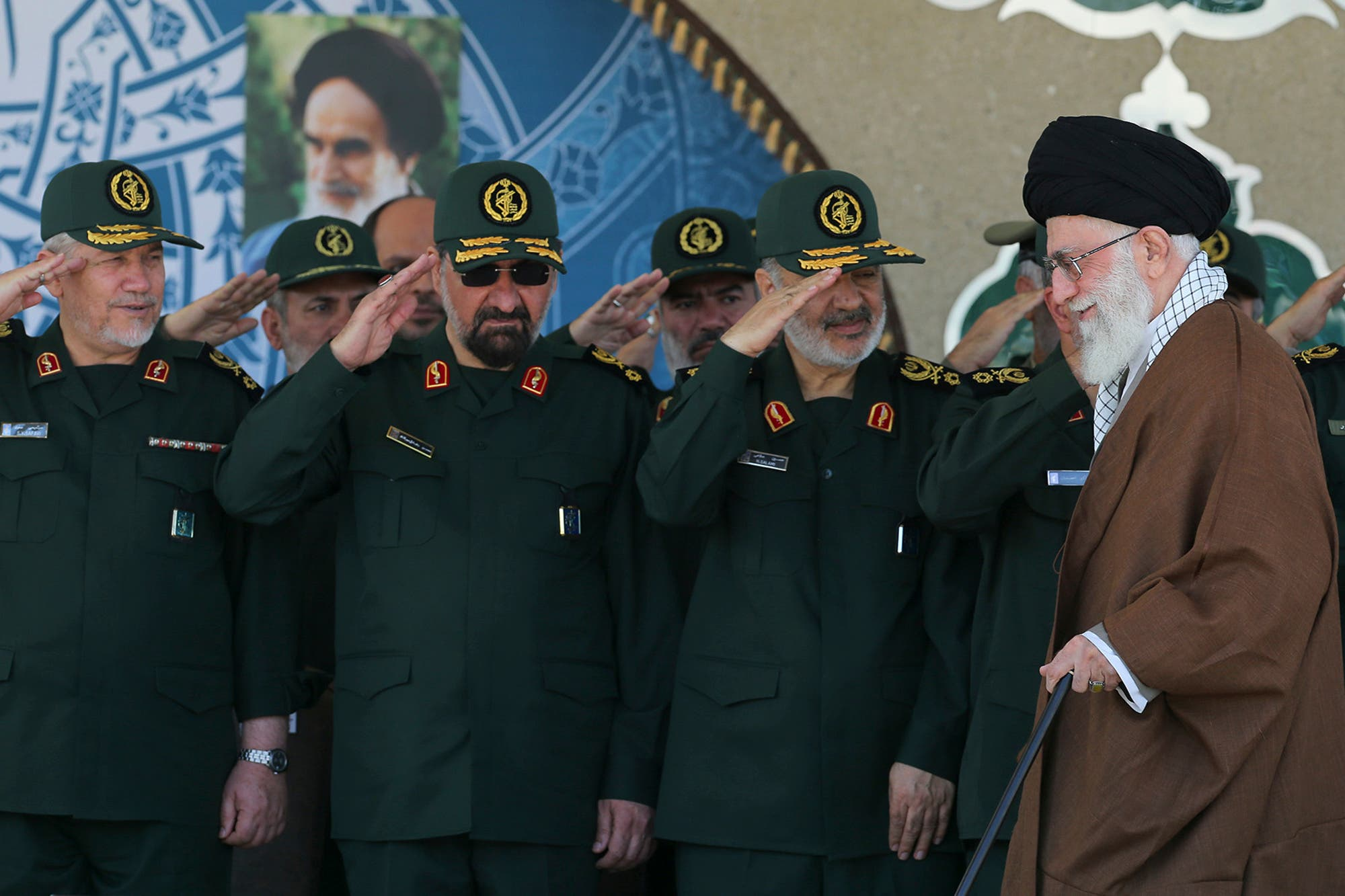 Supreme Leader Ayatollah Ali Khamenei, right, arrives at a Revolutionary Guard ceremony, while deputy commander of the Revolutionary Guard, Hossein Salami, second right, another other former commanders salute him in Tehran, Iran. (AP)