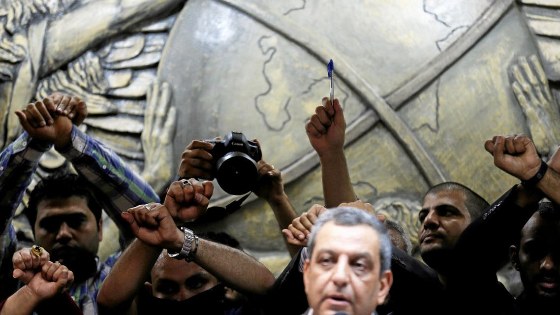 Journalists gesture in protest against the arrests of fellow journalists, during a news conference by Yehia Kalash, head of Egyptian press syndicate, on World Press Freedom Day at the syndicate's headquarters in downtown Cairo, Egypt May 3, 2016.