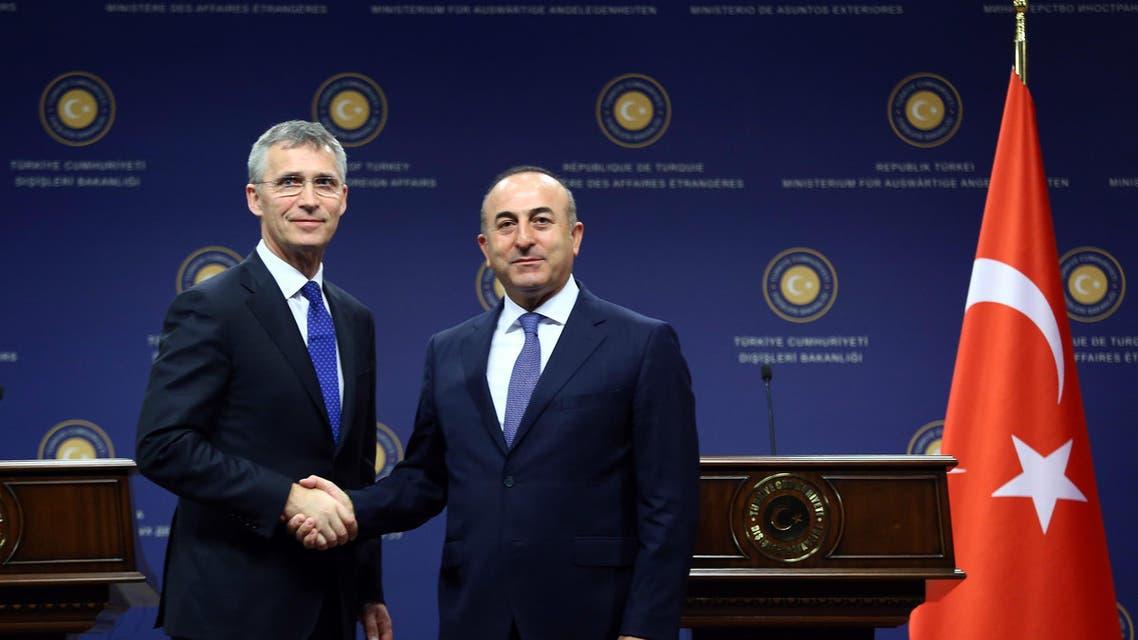 NATO secretary general Jens Stoltenberg (L) and Turkish Foreign Minister Mevlut Cavusoglu الأمين العام للناتو ووزير الخارجية التركي