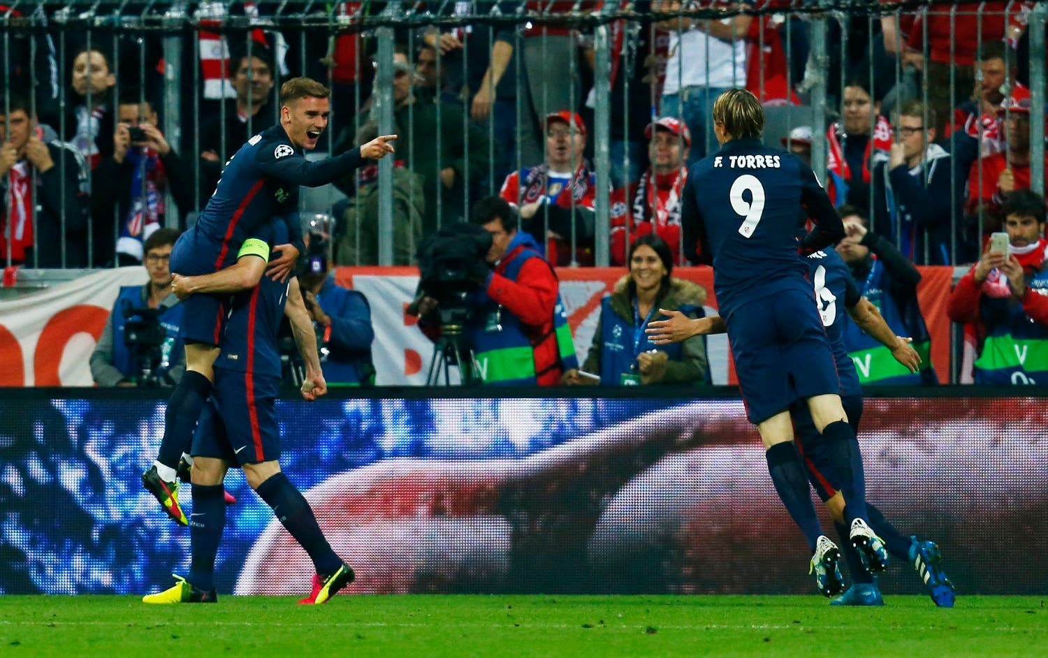Atletico Madrid's Antoine Griezmann celebrates scoring their first goal. (Reuters)