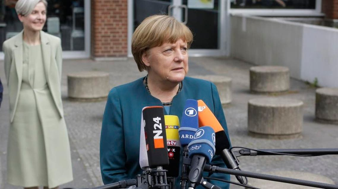 German Chancellor Angela Merkel briefs the media after she visited a European project day at the Lycee Francais school in Berlin, Germany, Tuesday, May 3, 2016. (AP)