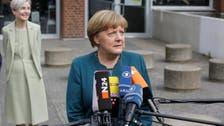 Merkel lends backing to halt rise of France's far-right