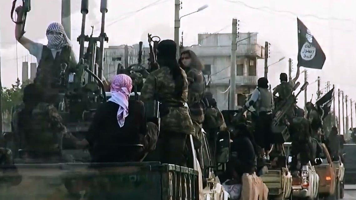 An image grab taken from a propaganda video released on March 17, 2014 by the Islamic State of Iraq and the Levant (ISIL)'s al-Furqan Media allegedly shows ISIL fighters driving on a street in the northern Syrian City of Homs (AFP)