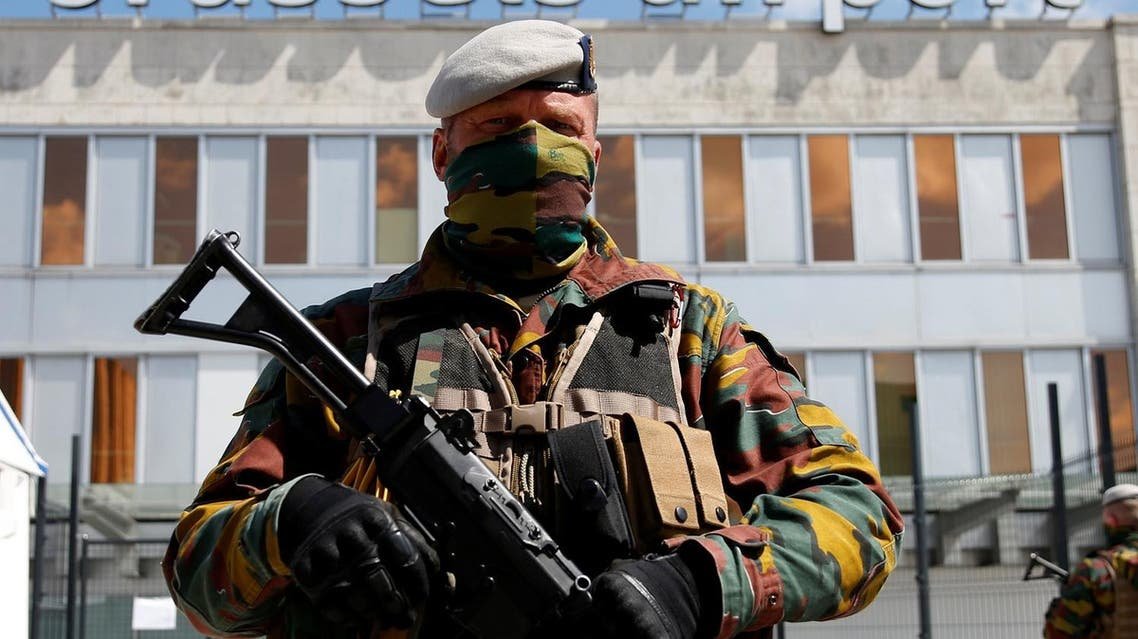 A Belgian soldier stands guard outside the partially reopened departure hall of Zaventem international airport near Brussels, Belgium, May 3, 2016. REUTERS