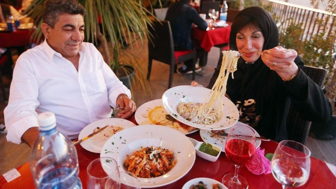 """Customers done at Toucan, a Mediterranean """"fusion"""" eatery in once-bustling Tripoli. (AFP)"""