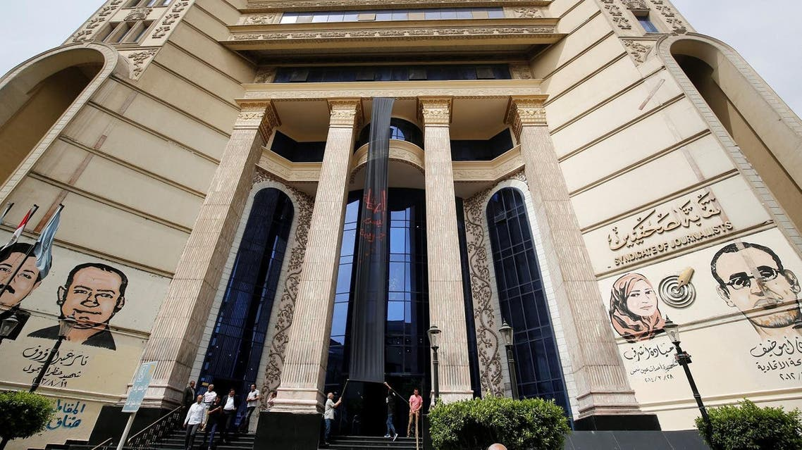 """Dozens of journalists rallied outside the union headquarters on Wednesday, chanting """"Journalism is not a crime!"""" and demanding the dismissal of the country's Interior Minister Magdy Abdel-Ghaffar. (Reuters)"""