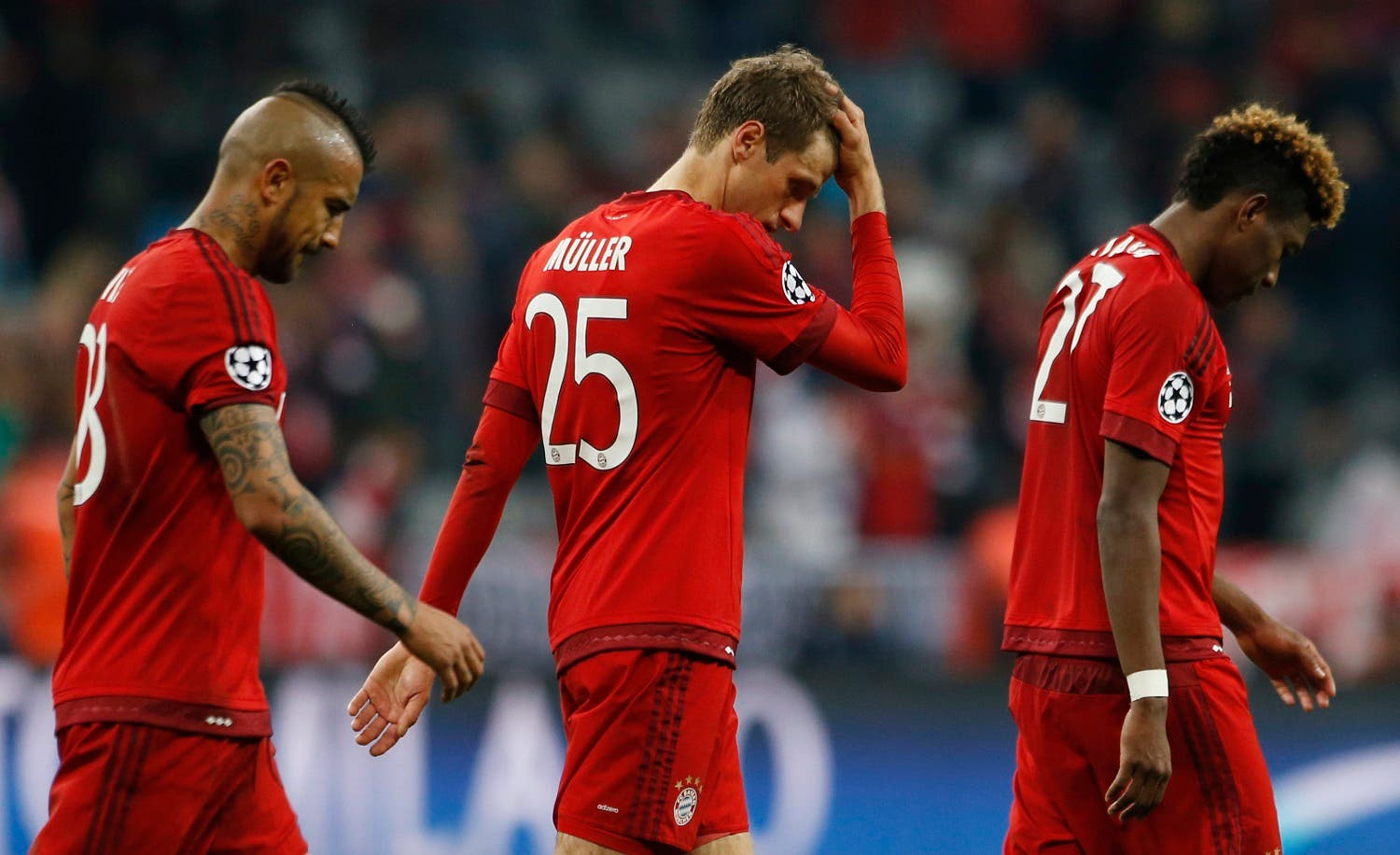 Bayern Munich's Arturo Vidal, Thomas Muller and David Alaba look dejected after the game Reuters
