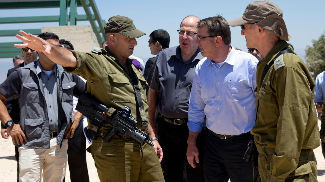 From left, Israel Defense Forces (IDF) 91st Division Commander Moni Katz, directing his right arm forward, Israeli Defense Minister Moshe Ya'alon, US Defense Secretary Ash Carter and Deputy Chief of Staff Maj. Gen. Yair Golan pause as they walk from viewing Hula Valley from the Hussein Lookout, behind them, near Kiryat Shmona, Israel, Monday, July 20, 2015, in northern Israel along the boarder with Lebanon. (AP)