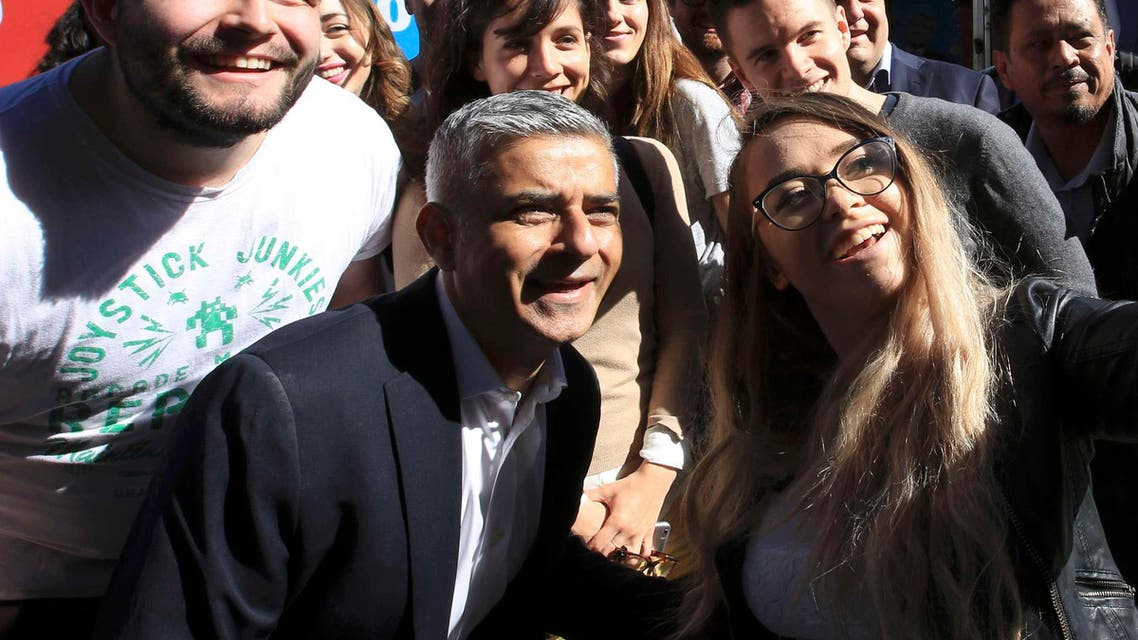 Sadiq Khan, Britain's Labour Party candidate for Mayor of London, poses for a selfie with supporters at Canary Wharf in London, Britain May 4, 2016.  (Reuters)
