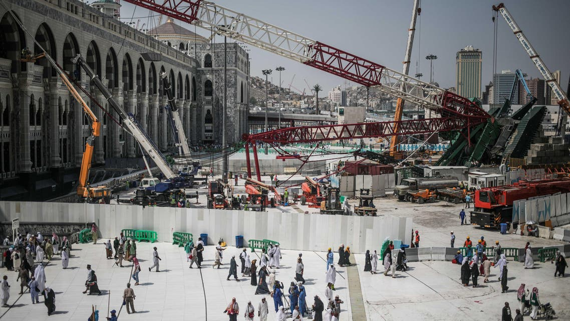 In this Tuesday, Sept. 15, 2015 file photo, Muslim Pilgrims walk past the site of a crane collapse that killed over a hundred Friday at the Grand Mosque in the holy city of Makkah, Saudi Arabia. (AP)