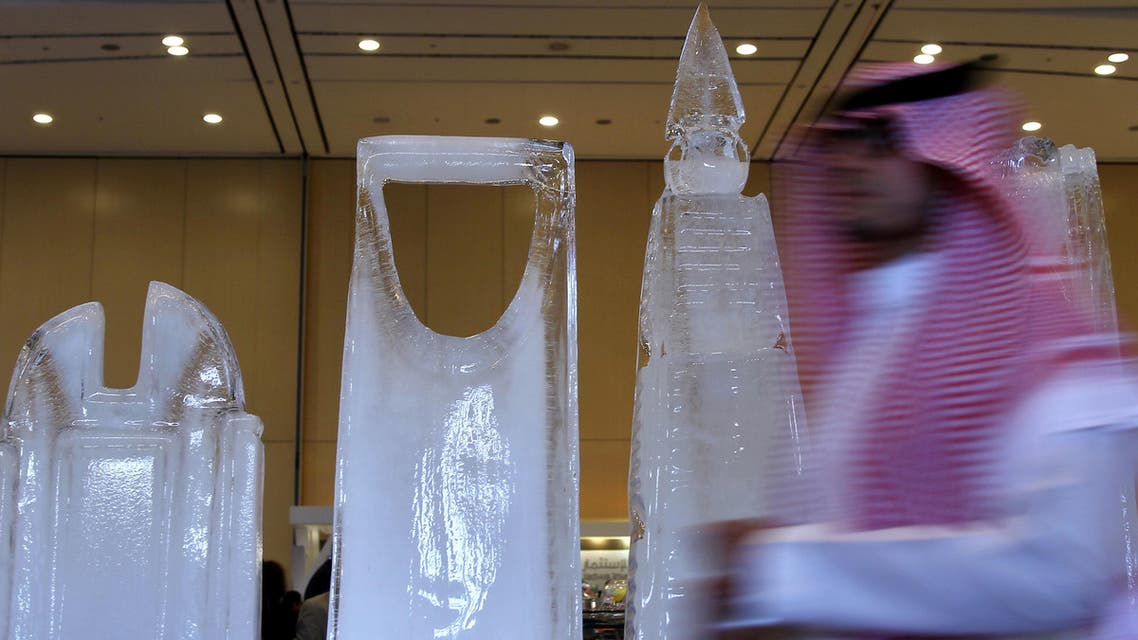 A participant walks past ice sculptures as he arrives for a Euromoney conference in Riyadh, Saudi Arabia May 3, 2016. (Reuters)