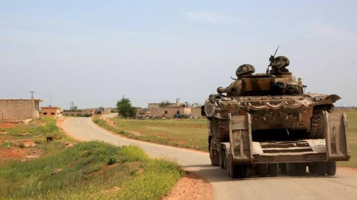 File photo of Syrian government forces' tanks patrolling Khan Tuman, south of the northern city of Aleppo. (AFP)