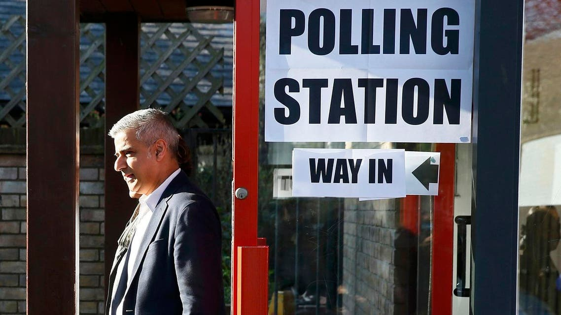 Sadiq Khan, Britain's Labour Party candidate for Mayor of London and his wife Saadiya leave after casting their votes for the London mayoral elections at a polling station in south London Britain May 5, 2016. REUTERS/Stefan Wermuth
