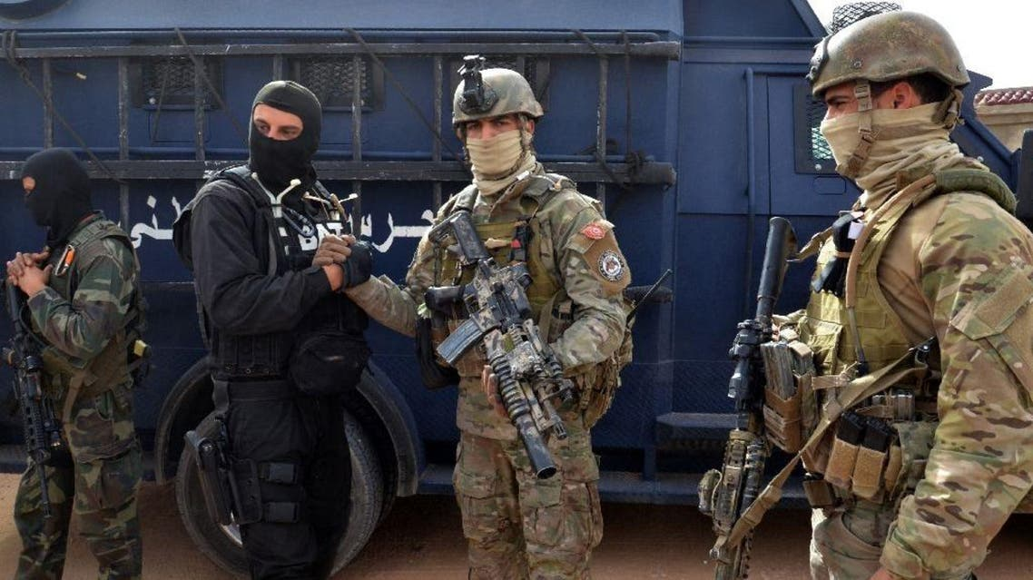 Tunisian special forces, like these pictured on March 21, 2016, have dismantled two Al-Qaeda-linked terrorist cells that were planning to carry out attacks against shopping malls and political parties. (AFP)