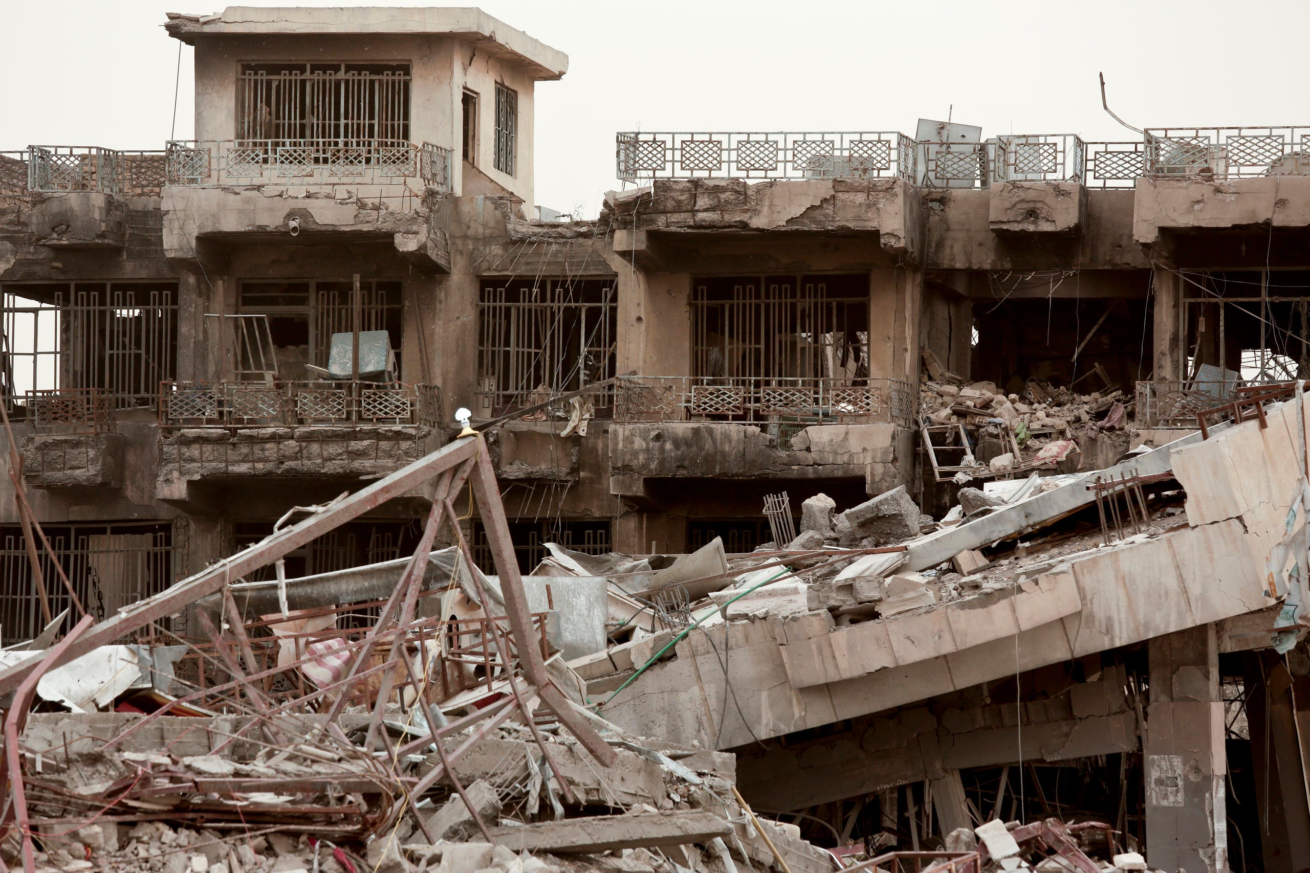 Two buildings in Haji Ziad Square in of the Iraqi city of Ramadi show extensive damage in this March 20, 2016, photo, months after U.S.-backed Iraqi forces freed the city from the Islamic State group. (AP)