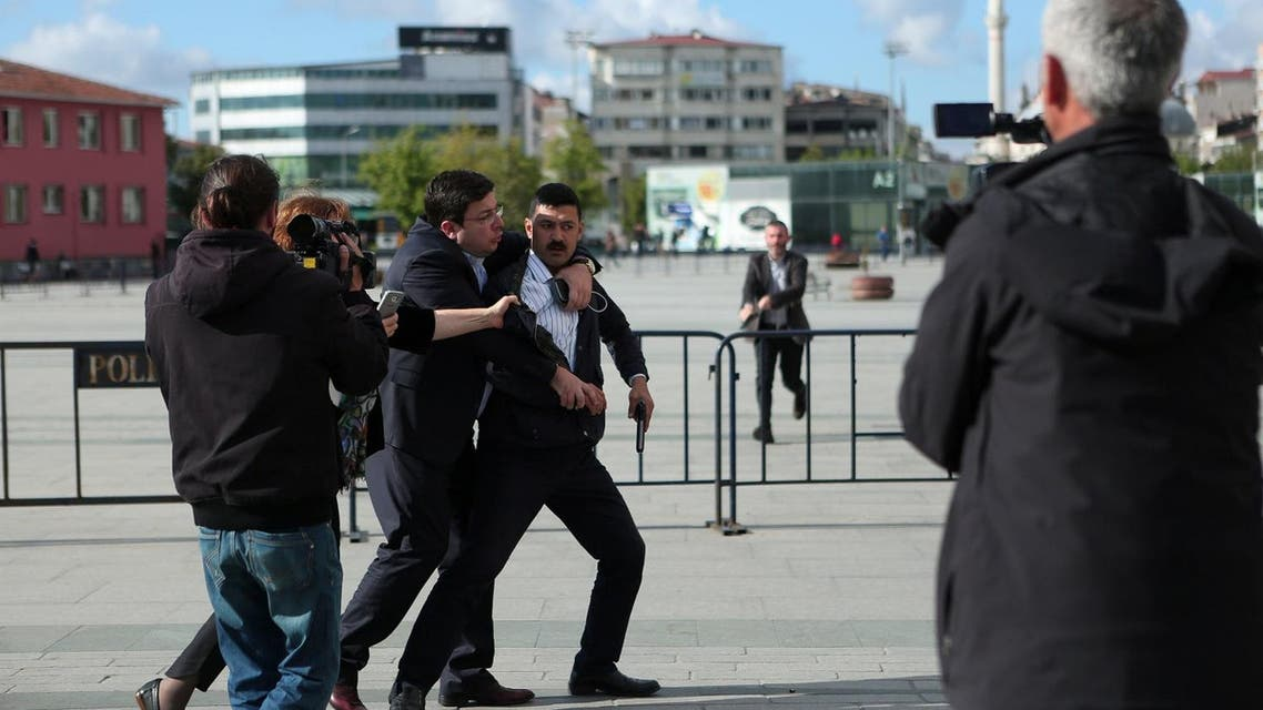 An assailant who attempted to shoot prominent Turkish journalist Can Dundar is caught by Dilek Dundar, wife of Can Dundar, and an unidentified man outside a courthouse in Istanbul, Turkey May 6, 2016. Can Erok/Cumhuriyet via REUTERS