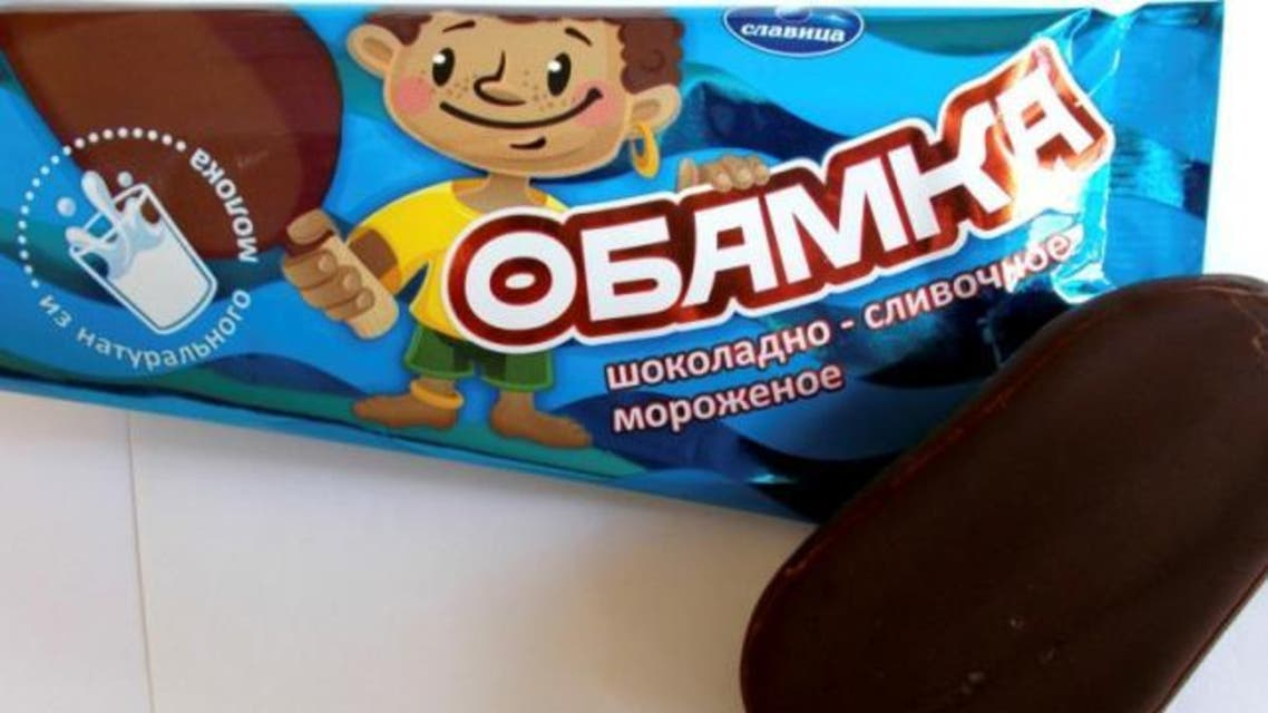 """The product, called """"Obamka"""" in Russian, is glazed with chocolate and its wrapping features an image of a smiling young African boy. (Handout/ Reuters)"""