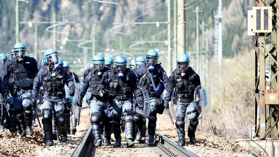 Italian riot police wait for demonstrators during a protest against a plan to restrict access through the Brenner Pass between Italy and Austria, in Brenner, Italy, May 7, 2016. REUTERS/Dominic Ebenbichler