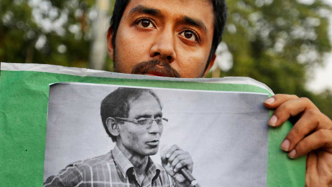 A Bangladeshi student holds a portrait of a University Professor A.F.M. Rezaul Karim Siddique during a protest against the killing in Dhaka, Bangladesh, Friday, April 29, 2016. Professor Siddique was hacked to death on his way to work at the state-run university in the Bangladeshi city of Rajshahi on April 23, 2016, where he taught English. The Islamic State group claims responsibility, but the government dismissed the claim and instead blames local religious radicals. (AP Photo)