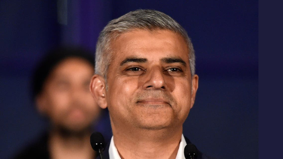 Labour Party candidate for Mayor of London Khan smiles following his victory in London. (Reuters)