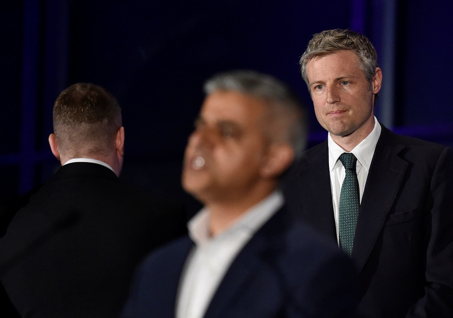 Zac Goldsmith, Britain's Conservative Party candidate for Mayor of London (R) and Paul Golding, Mayor of London candidate for Britain First (L), react as Britain's Labour Party candidate for Mayor of London Sadiq Khan speaks following his victory in the London mayoral election at City Hall in London, Britain, May 7, 2016. REUTERS/Toby Melville
