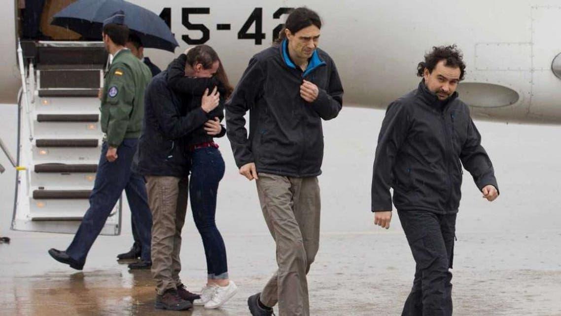 3 reporters, spain (AP)