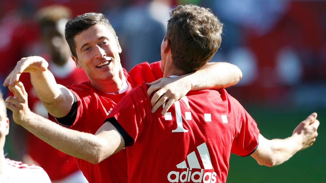 The Bavarians clinched a 26th German league crown, and their first silverware of the season, thanks to two goals from top scorer Robert Lewandowski in the first half. (Reuters)