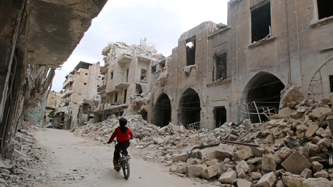 A boy rides a bicycle near damaged buildings in the rebel held area of Old Aleppo, Syria May 5, 2016. (Reuters)