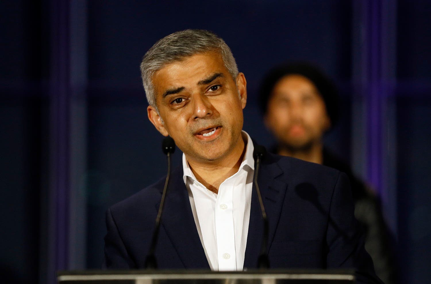 Sadiq Khan speaks on the podium after hearing the results of the London mayoral elections, at City Hall in London, Saturday, May 7, 2016. (AP Photo/Kirsty Wigglesworth)