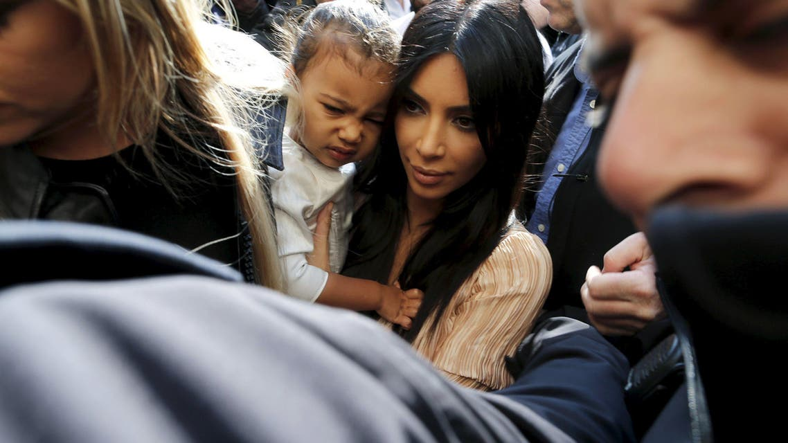 Kim Kardashian holds her toddler daughter North West as they arrive for a baptism ceremony at the Cathedral of Saint James. (Reuters)
