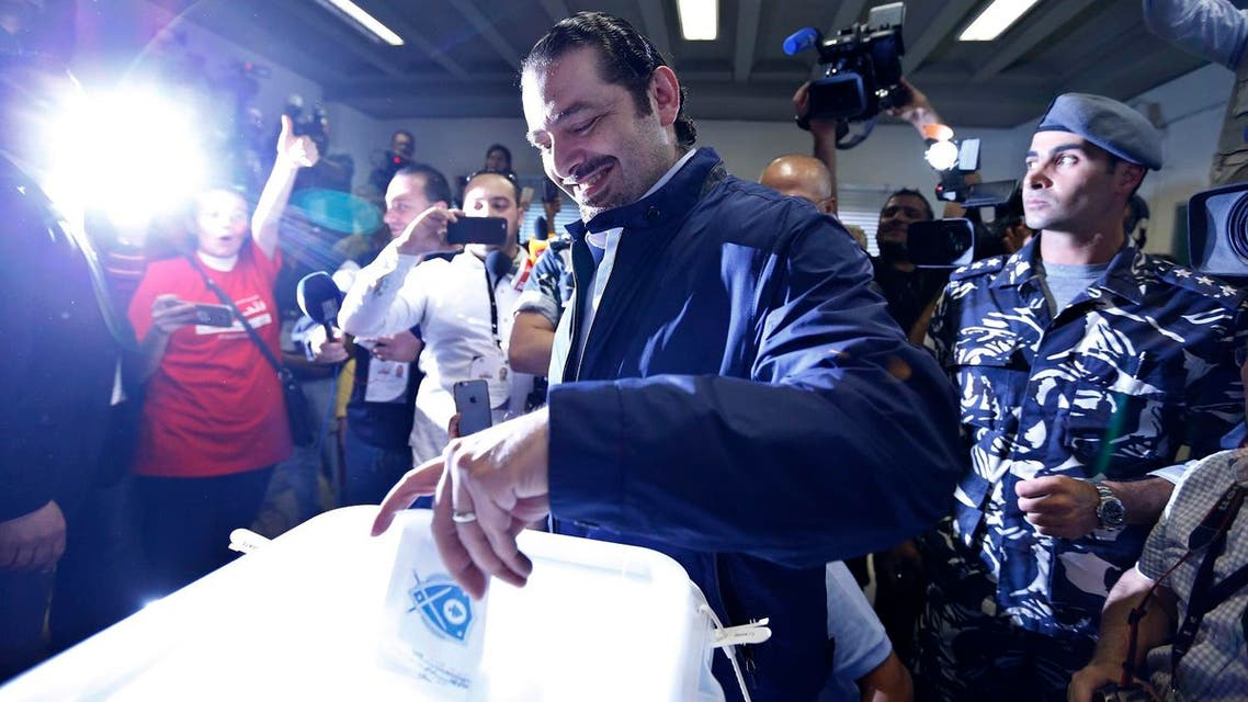 Former Lebanese Prime Minister Saad Hariri, center, leader of Lebanon's parliamentary majority, casts his vote at a polling station during the municipal elections in Beirut. (AP)
