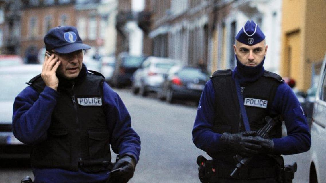 Belgian police stand guard on a street in Verviers during an anti-terror raid in January (AFP Photo/John Thys)