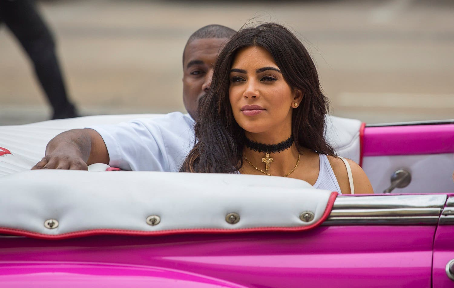 American reality-show star Kim Kardashian West and her husband, rap superstar, Kanye West ride on a classic car in Havana, Cuba, Wednesday, May 4, 2016. AP