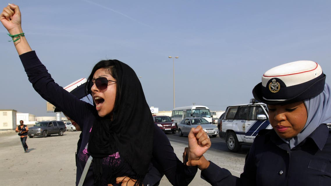 In this Oct. 21, 2012 file photo, Bahraini opposition activist Zainab al-Khawaja, left, gestures while being arrested by police officers in Eker, Bahrain. (AP)