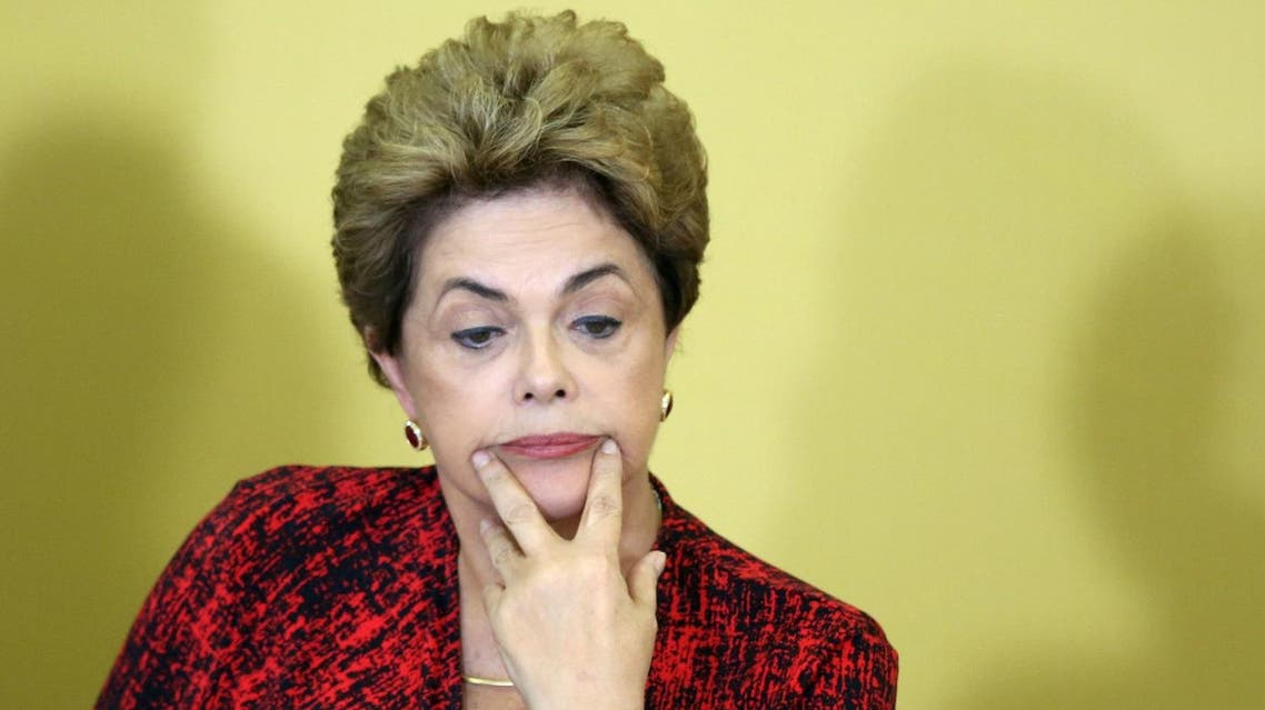 Brazil's President Dilma Rousseff reacts as she attends a signing ceremony for new universities, at Planalto Palace in Brasilia, Brazil, May 9, 2016. REUTERS