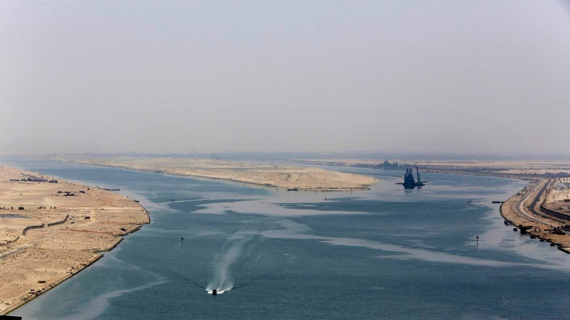 In this Aug. 6, 2015 file photo, an army zodiac secures the entrance of the new section of the Suez Canal in Ismailia, Egypt. Toll revenues for Egypt's Suez Canal fell in September 2015, dampening hopes that a new parallel waterway -- which authorities claimed would more than double canal income in the next seven years -- will boost the economy in the immediate future. Data released on Monday, Oct. 25, 2015, by canal authorities shows that monthly revenue was $448.8 million in September, down some $13 million from the previous month. (AP Photo/Amr Nabil, File)