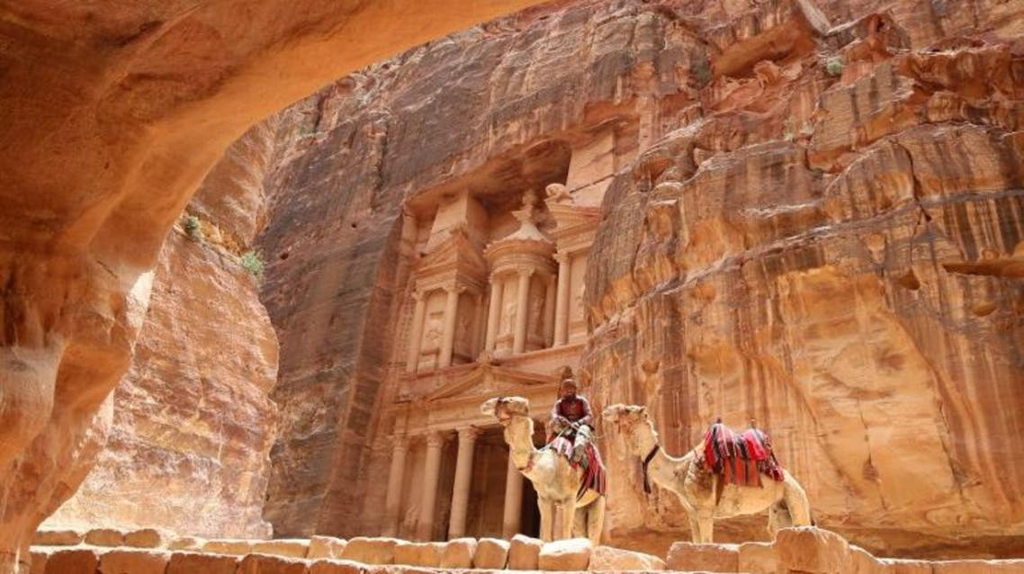 A Jordanian Bedouin sits on a camel in front of the Treasury Building in the ancient city of Petra in Jordan on May 9, 2016. AFP