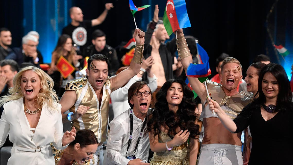 Azerbaijan's Samra celebrates with her team after qualifying in the first Eurovision Song Contest semifinal in Stockholm, Sweden, Tuesday, May 10, 2016. (AP Photo/Martin Meissner)