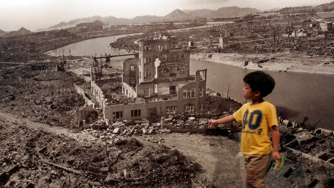A boy looks at a huge photograph showing Hiroshima city after the 1945 atomic bombing, at the Hiroshima Peace Memorial Museum, Japan August 6, 2007. (Reuters)