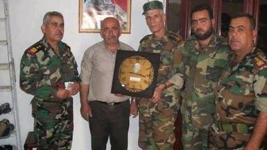 """بالصور.. الأسد يكرم قتلاه بـ""""ساعة حائط""""!"""