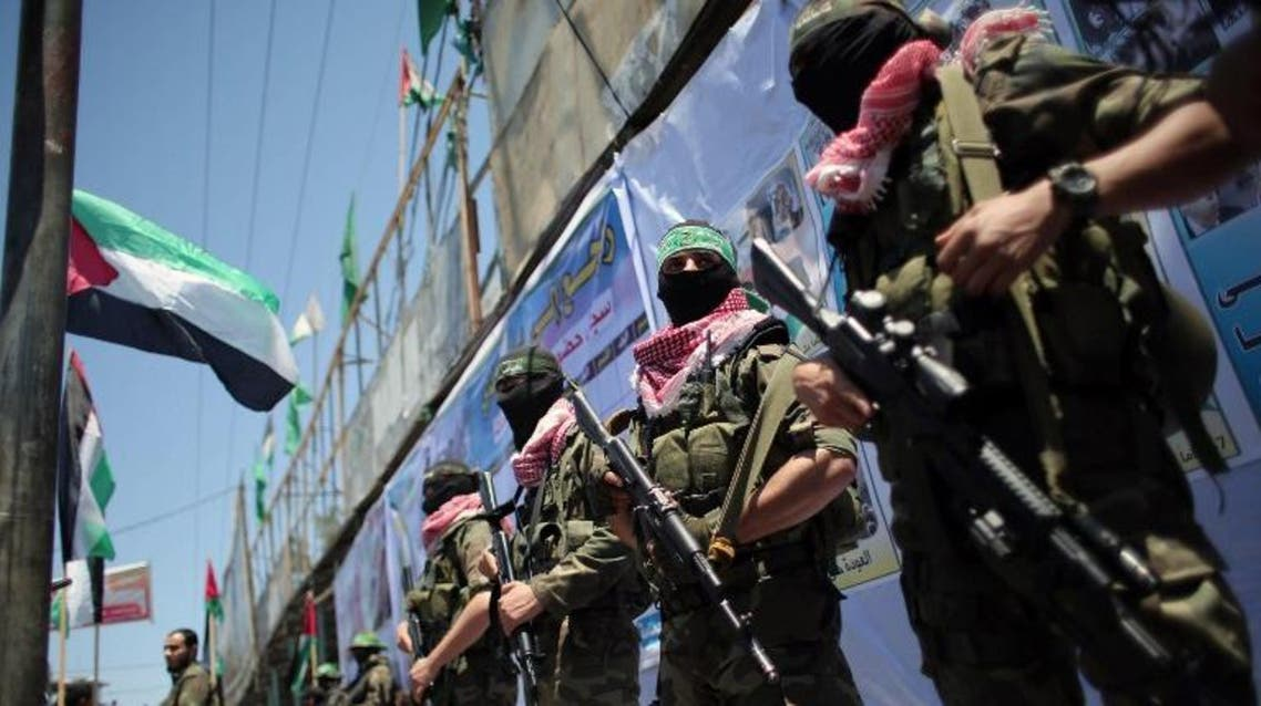 Palestinian militants of the Ezzedine al-Qassam Brigades, Hamas' armed wing, take part in a parade in the southern Gaza Strip town of Rafah on May 17, 2015 to mark the 67th anniversary of the Nakba. AFP