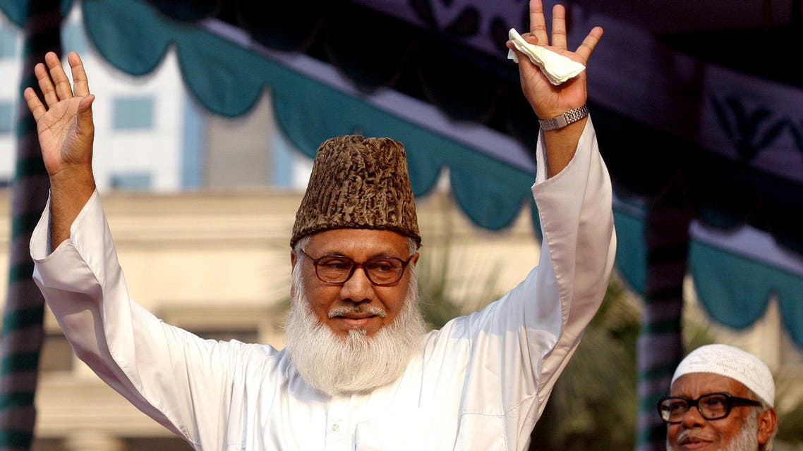 Moulana Motiur Rahman Nizami, chief of the Jamaat-e-Islami, Bangladesh's biggest Islamic Political Party and an alliance of the ruling Bangladesh Nationalist Party, waves to his supporters during a rally in Dhaka REUTERS