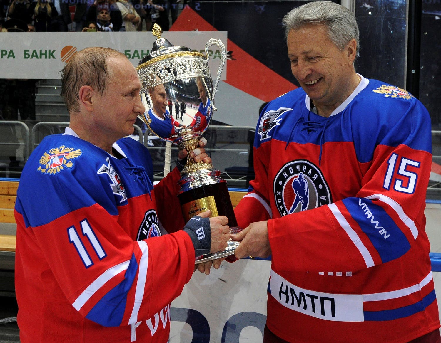 Russian President Vladimir Putin and Soviet former player Alexander Yakushev hold a trophy as they take part in a gala game of the Night Ice Hockey League in Sochi, Russia, May 10, 2016. Mikhail Klimentyev/Sputnik/Kremlin via Reuters
